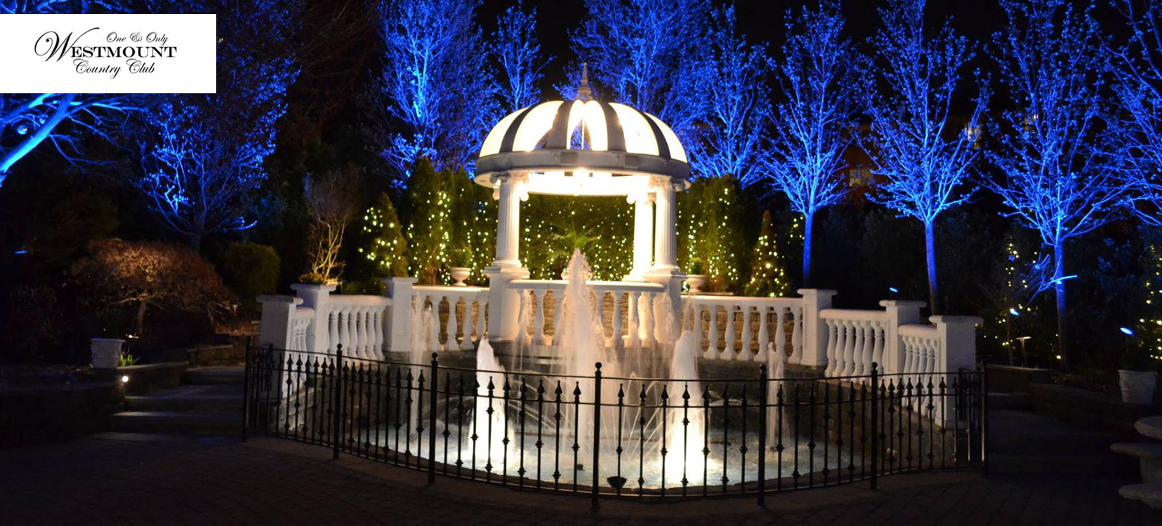 Nighttime photo of the fountain at The Westmount Country Club
