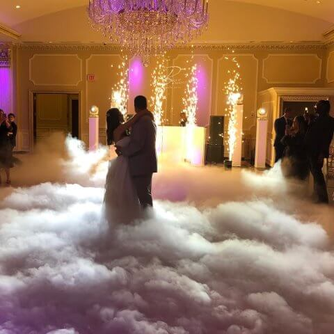 couple dances on clouds with dj in background